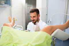Success gynecologist examination. Doctor with patient doing gynecology exam stock photos