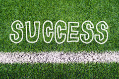 SUCCESS hand writing text on soccer field grass Stock Images