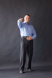 Success handsome man standing in studio. Finger Stock Images
