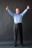 Success handsome man standing in studio. Finger Stock Photo