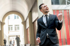 Success. Happy businessman celebrates his success. young man in Royalty Free Stock Images