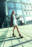 Success Happy Young Woman Walking In City Sunlight stock photo