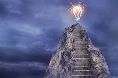 Success and innovation concept. Abstract mountain ladder with polygonal light bulb on top on abstract dark sky background. Success and innovation concept. 3D Royalty Free Stock Photos