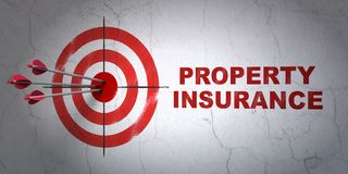Insurance concept: target and Property Insurance on wall background Stock Photos