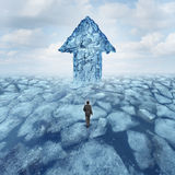 Success Journey Concept. As a businessman walking on broken frozen ice with an iceberg shaped as an arrow as a metaphor for danger risk and opportunity Royalty Free Stock Photos