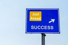 Success Just Ahead Blue Road Sign Against sky Stock Image
