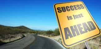 Success is just ahead road sign. On a sky background and dessert road stock photo