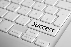 Success Keyboard. Computer Keyboard with big Succes button. Shallow deep of field Stock Images