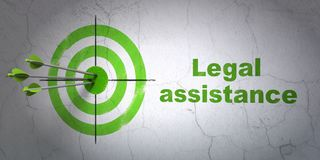Law concept: target and Legal Assistance on wall background. Success law concept: arrows hitting the center of target, Green Legal Assistance on wall background Royalty Free Stock Images