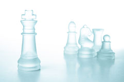 Success and leadership concept, glass chess king. Success and leadership concept, glass chess piece king on a white background isolated Stock Photography