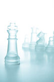 Success and leadership concept, glass chess king. Success and leadership concept, glass chess piece king on a white background isolated Royalty Free Stock Images