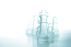 Success and leadership concept, glass chess king. Success and leadership concept, glass chess piece king on a white background isolated Stock Images