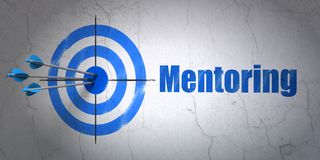 Learning concept: target and Mentoring on wall background. Success Learning concept: arrows hitting the center of target, Blue Mentoring on wall background, 3D Stock Photography