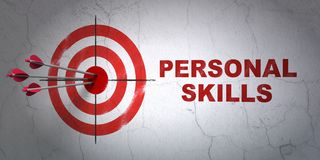 Learning concept: target and Personal Skills on wall background. Success Learning concept: arrows hitting the center of target, Red Personal Skills on wall Stock Photo