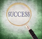 Success magnify. By 3d rendered magnifying glass on green grunge background Royalty Free Stock Images
