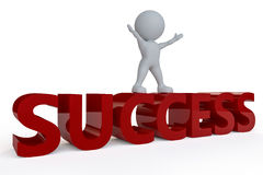 Success Man. A dummy man standing on top of the word success with his arms raised set against a white background Stock Images