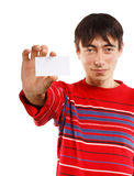 Success man with business card. Success man in red striped sweater on white background with business card Stock Images