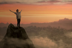 Success man on mountain peak Stock Image