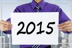 Success man showing number 2015 Stock Photos