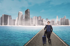 Success man standing on the road with luggage Royalty Free Stock Photography