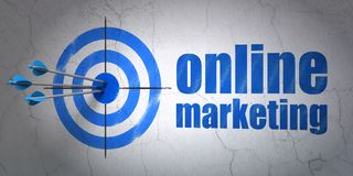 Marketing concept: target and Online Marketing on wall background. Success marketing concept: arrows hitting the center of target, Blue Online Marketing on wall Stock Images