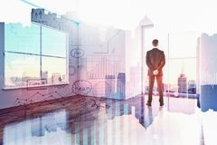 Success and marketing concept. Businessman in modern office interior with abstract business sketch hologram. Success and marketing concept. Double exposure Royalty Free Stock Photo