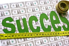 Success Measure. Concept, dollars background and tape measure across the word success Royalty Free Stock Images