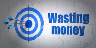 Money concept: target and Wasting Money on wall background Stock Image