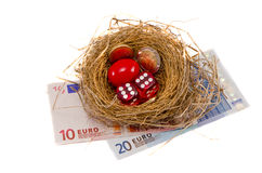 Success nest with money and dice on white Royalty Free Stock Image