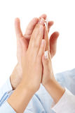 Success, partnership and teamwork concept. Hands of a successful business team on a white background Stock Photos