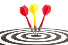 Success and Perfection. Three Darts hitting the middle of dartboard Stock Image