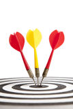 Success and Perfection. Three Darts hitting the middle of dartboard Royalty Free Stock Image