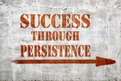 Success through persistence  graffiti on stucco wall Royalty Free Stock Image