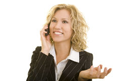 Success on the phone. Blonde business woman using her mobile phone and smiling stock photography
