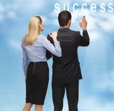 Success. Picture of men and women with success word button in the sky Stock Photo