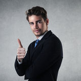 Success. Portrait of happy businessman with his thumb upwards stock images