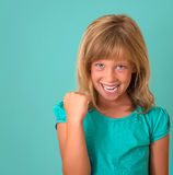 Success. Portrait winning successful little girl happy ecstatic celebrating being winner isolated turquoise background. Stock Photo