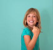 Success. Portrait winning successful little girl happy ecstatic celebrating being winner isolated turquoise background. Positive