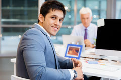 Success and professionalism in person. Businessman in office smiling at camera stock images