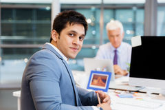 Success and professionalism in person. Businessman in office smiling at camera royalty free stock photo
