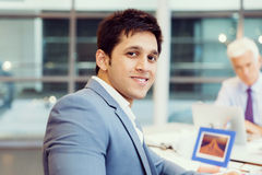 Success and professionalism in person. Businessman in office smiling at camera royalty free stock photography