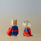 Success project managment concept and super team template. Clothespin peg light bulb heroes in blue suit red cape royalty free stock images