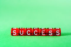 Success ,red  on green Royalty Free Stock Photo