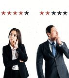 Success and review concept. Attractive young european businesswoman and businessman with star rating on subtle background. Success and review concept stock image
