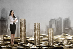 Success and rich business woman saving gold coin. Success and rich concept image Royalty Free Stock Photography
