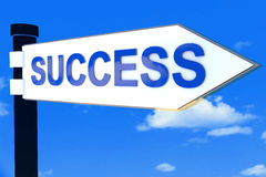 Success road direction sign. On sky Royalty Free Stock Photography