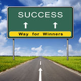 Success road sign on blue sky background Stock Image