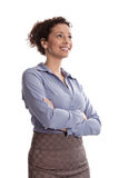 Success: satisfied business woman smiling wearing blue blouse f. Olding arms on white background with a blue blouse royalty free stock photos