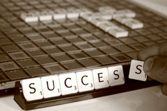 Success in scrabble. Photograph of someone spelling the word success in a game of scrabble Royalty Free Stock Image