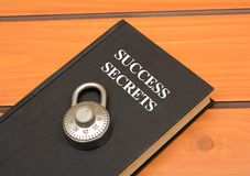 Success secrets concept with book on wooden background royalty free stock image